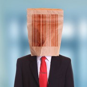 Man paper bag on head with barcode symbol
